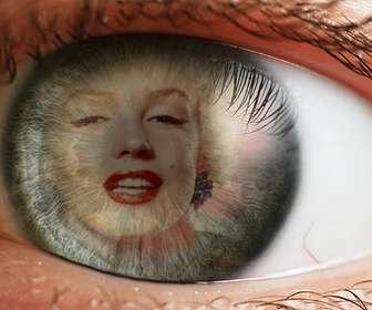 Créer un photomontage avec un œil et une image superposée sur liris et la pupille comme le reflet.